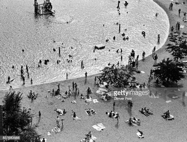 White Sands Beach Club privately owned lake in southeast Denver was a gleaming spot of coolness on a day in which the temperature climbed to a high...