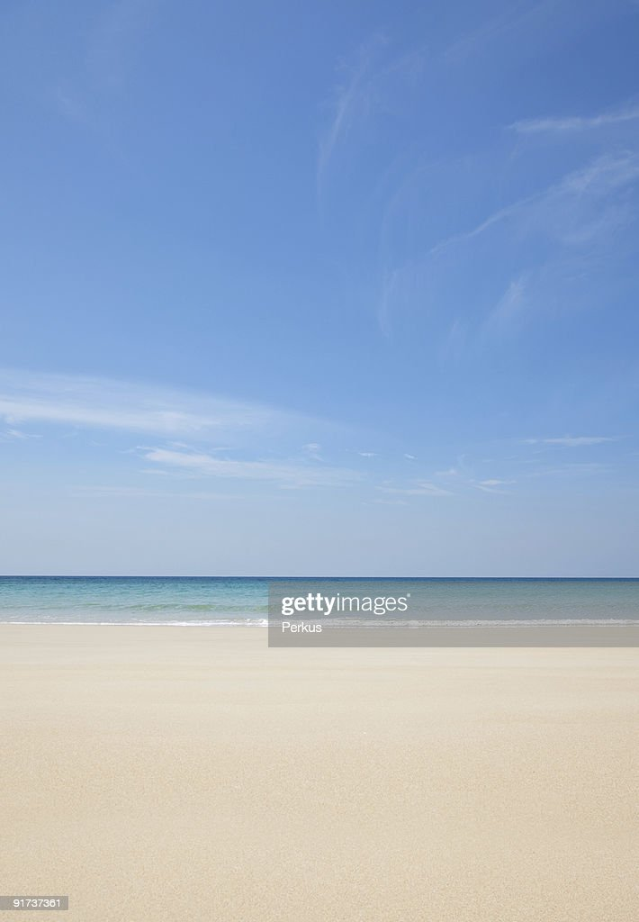 White sandy beach and a perfectly clear blue sky : Stock Photo