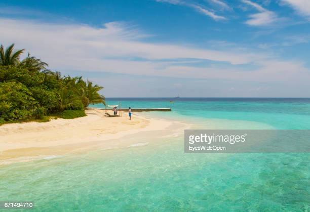 White sandy Beach and turquois Water at Coco Bodu Hiti NorthMaleAtoll on February 26 2017 in Male Maldives