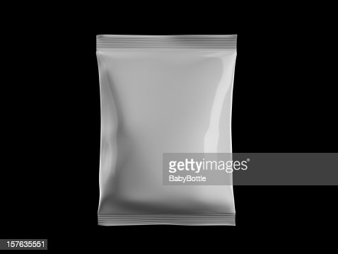 White sealed bag of candy on black background