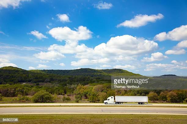 White semi-truck on freeway