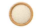 Top view of white sesame seeds in wooden bowl isolated on white background with clipping path