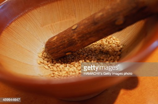 white sesami with grinding-bowl & stick grinder
