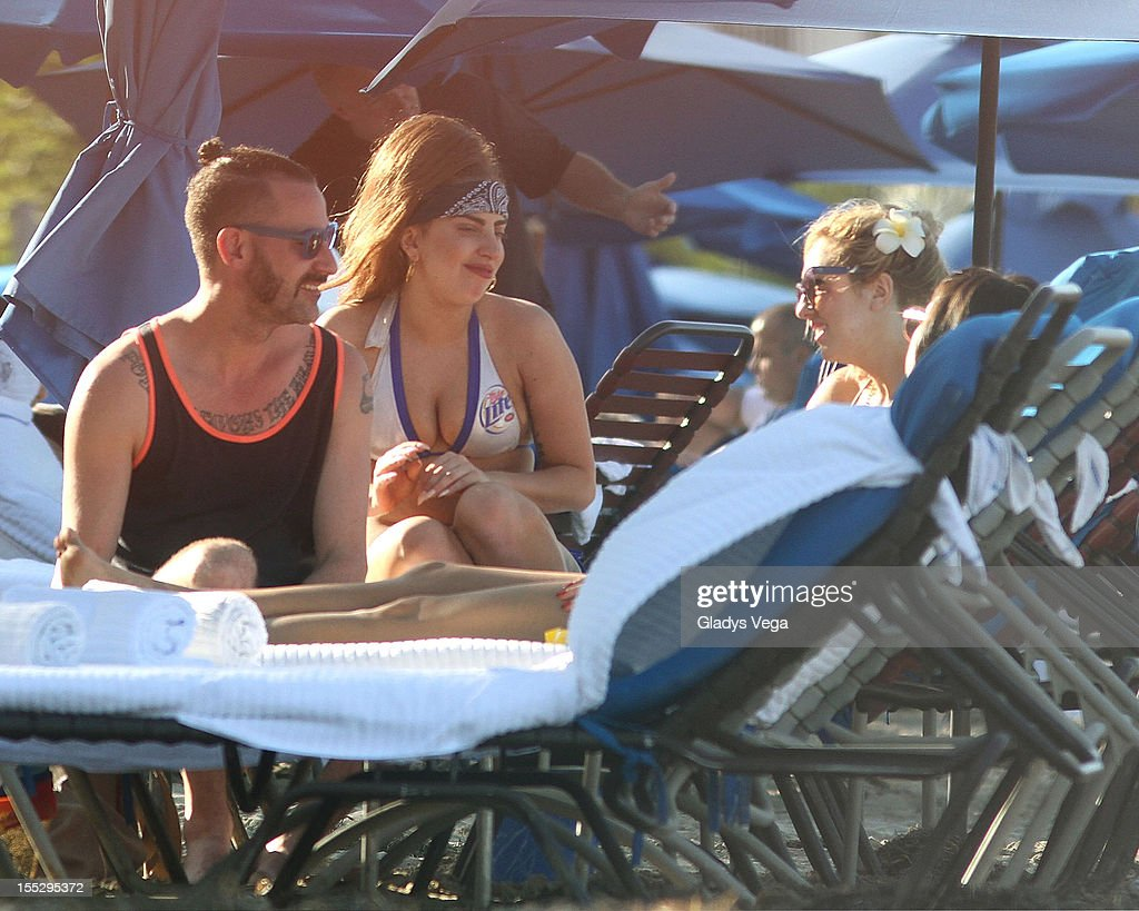 DJ White Shadow, Lady Gaga and Tara Savelo are seen on Isla Verde Beach on November 2, 2012 in San Juan, Puerto Rico.