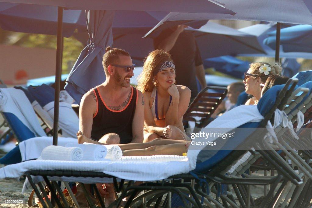 DJ White Shadow, Lady Gaga and Tara Savelo are seen on Isla Verde Beach on November 2, 2012 in San Juan, Puerto Rico.