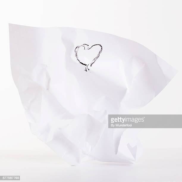 White sheet of paper with a black heart