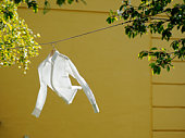 White shirt hanging on line, outdoors