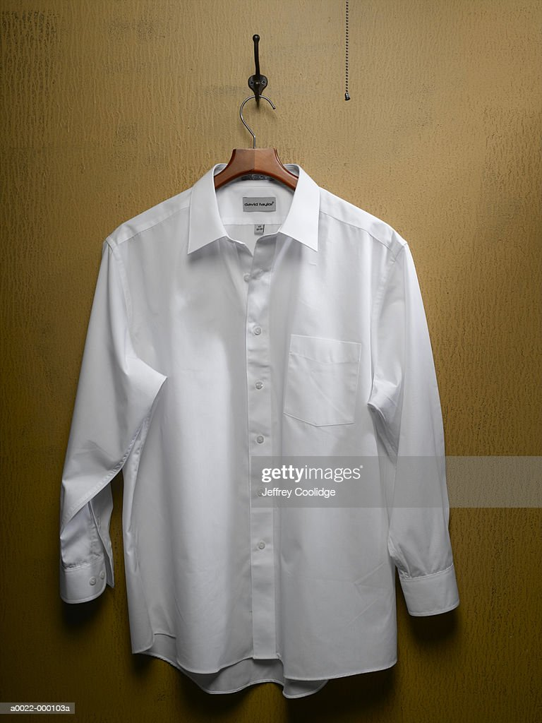 White Shirt on Closet Door : Stock Photo