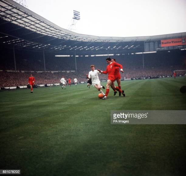 White shirted Leeds player Billy Bremner finds Liverpool players Ron Yeats Ian St John converging on him during the 1965 FA cup final