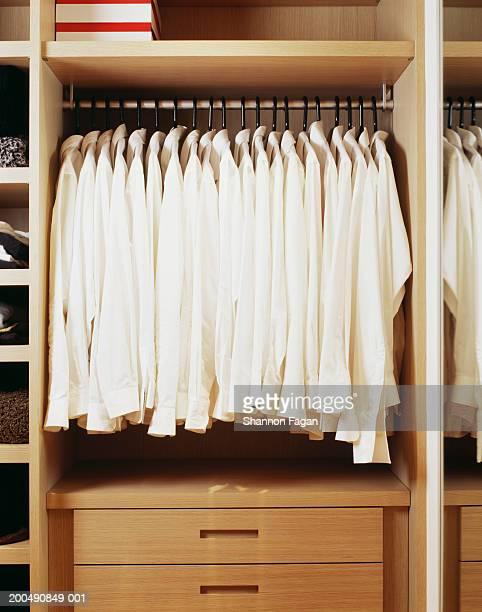 White shirts hanging in closet
