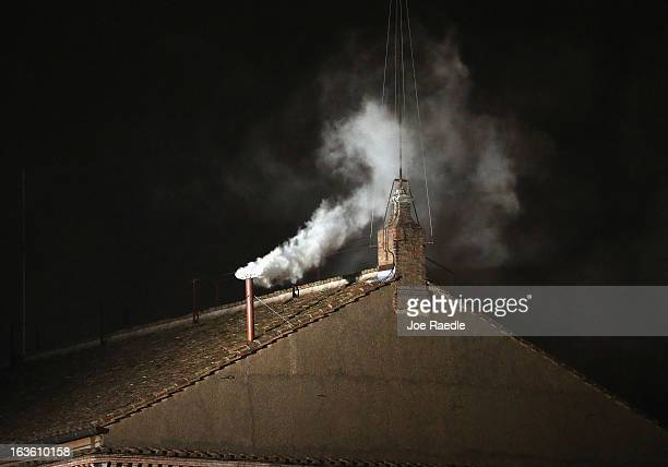 White smoke emits from the chimney on the Sistine Chapel as a new Pope is elected on March 13 2013 in Vatican City Vatican Pope Benedict XVI's...