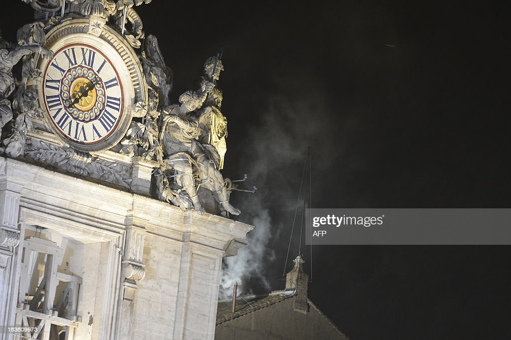 White smoke rises from the chimney on the roof of the Sistine Chapel meaning that cardinals elected a new pope in their ballot of their secret conclave on March 13, 2013 at the Vatican.