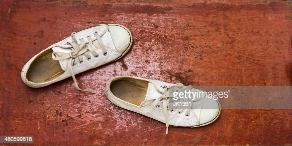 White sneakers on brown background. : Stock Photo