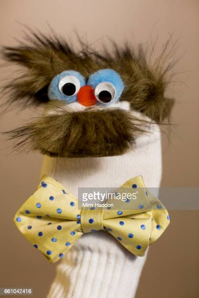 White Sock Puppet with Wild Hair and Moustache with Bow Tie