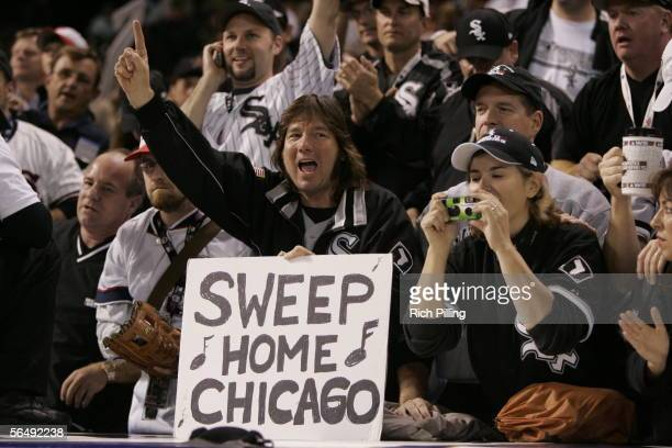 White Sox fans show off a sign reading 'Sweep Home Chicago' during Game Four of the Major League Baseball World Series between the Chicago White Sox...