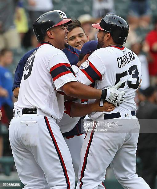 White Sox players including Jose Abreu mob Melkey Cabrera after he got the gamewinning hit a single in the 9th inning against the Detroit Tigers at...