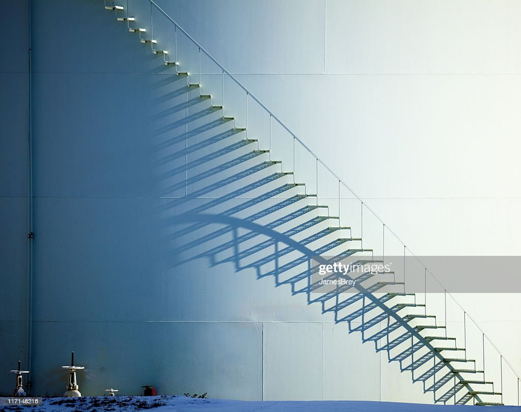 White Staircase and Shadow on Oil Storage Tank