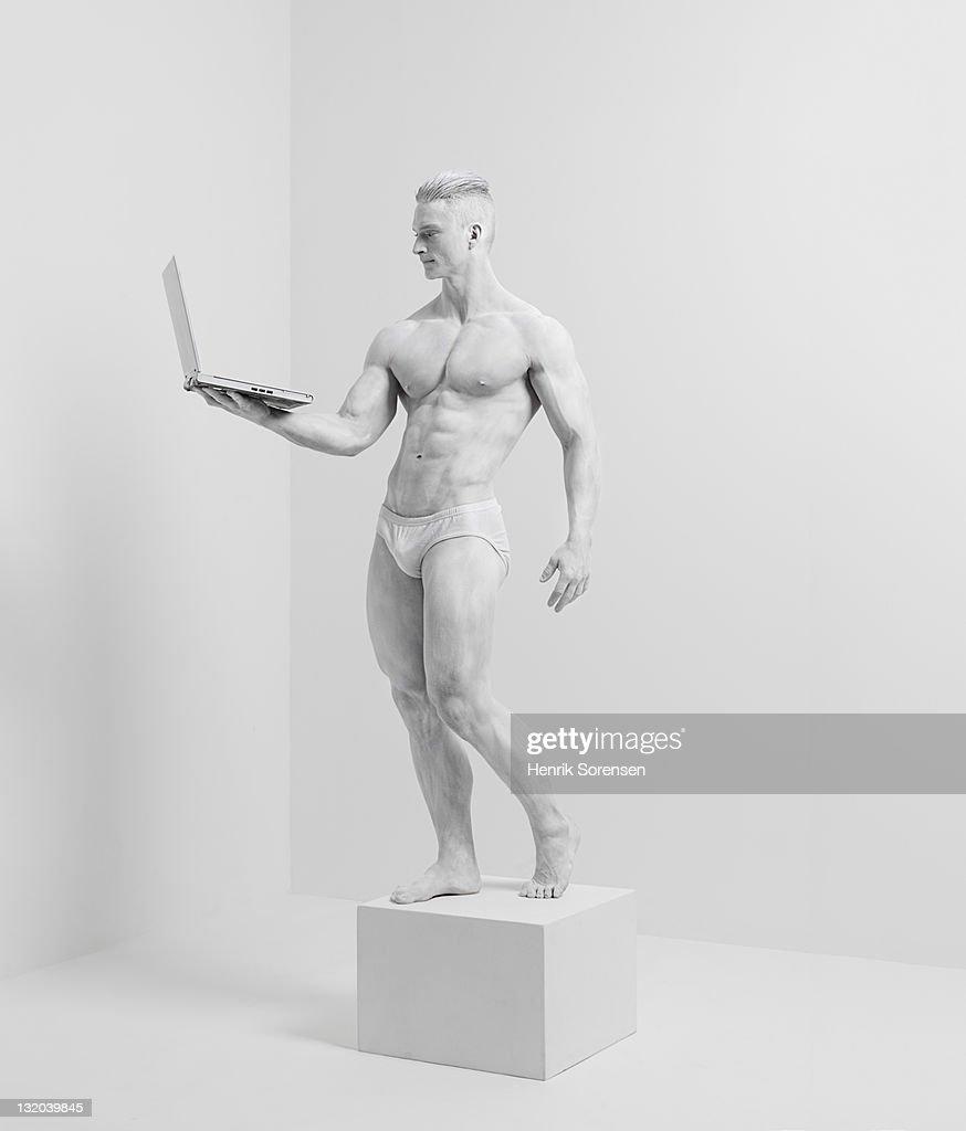 white statue in white room : Stock Photo