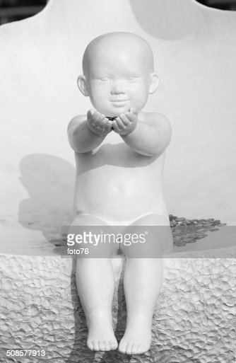 White statue of baby : Stock Photo
