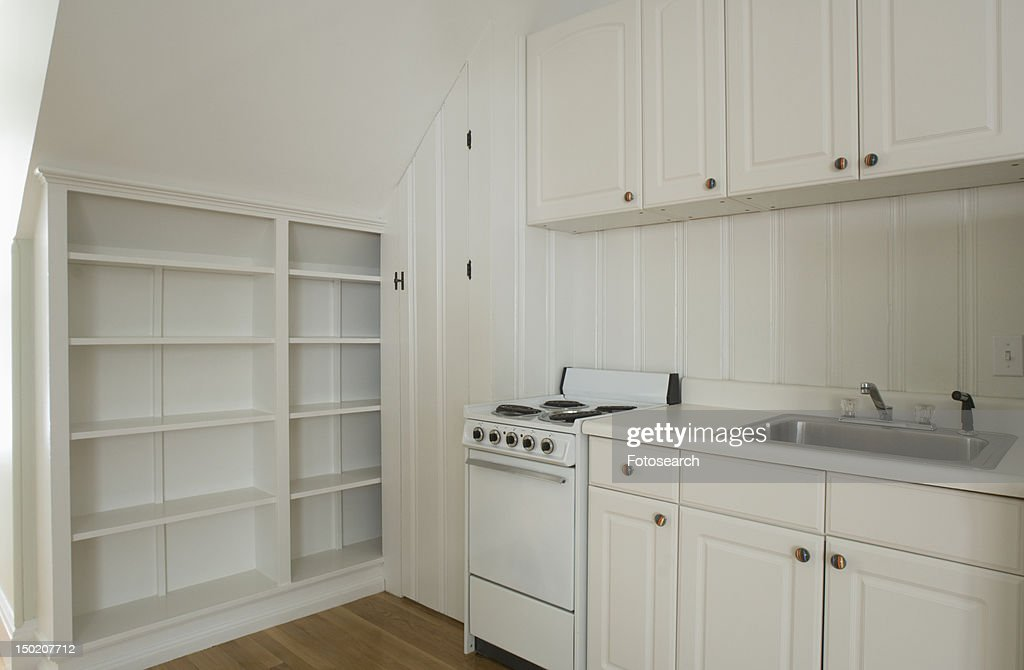 white stove and kitchen in empty apartment stock photo