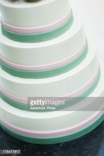 White Striped Fondant Wedding Cake On Table Stock Photo ...