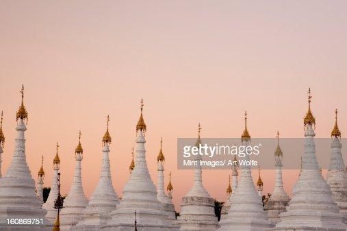 White stupas at Kuthodaw Pagoda, Mandalay, Myanmar : Stock Photo