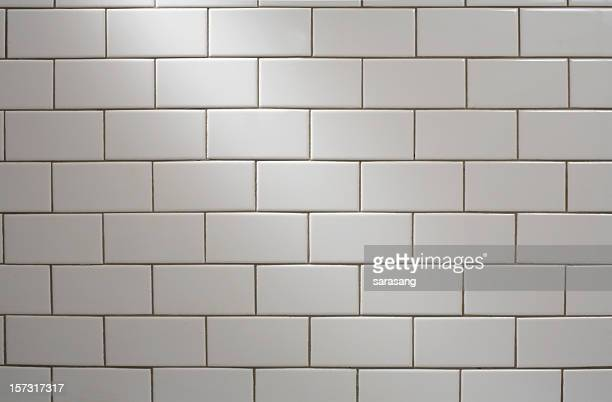 white subway tile with spotlight