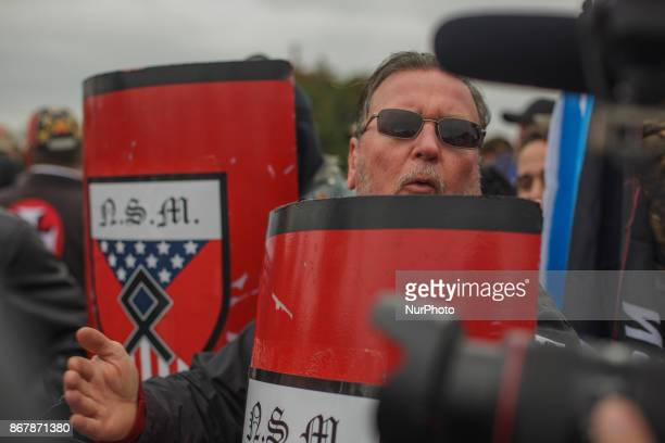 A white supremacist bangs on a shield in a form of applause in Shelbyville Tennessee Illinois US on 28 Ocotber 2017