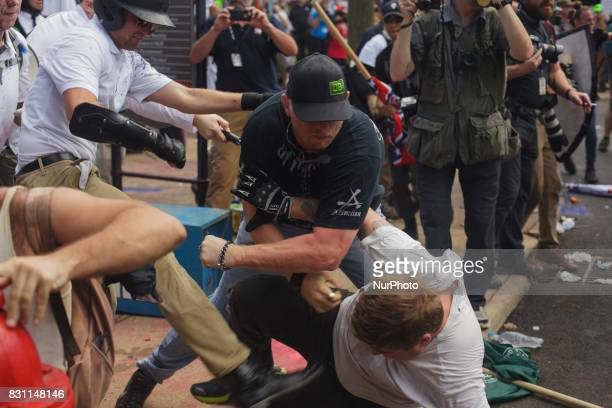 A White Supremacist beats a man into the ground in a brawl at Lee Park on 12 August 2017 in Charlottesville Virginia USA The Unite the Right...