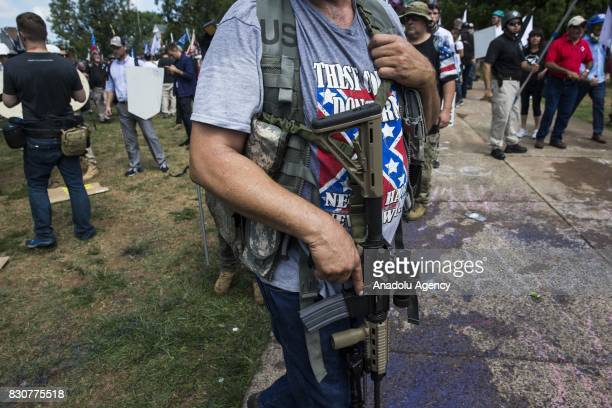 A White Supremacist open carries a rifle during clashes with counter protestors at Emancipation Park where the White Nationalists are protesting the...