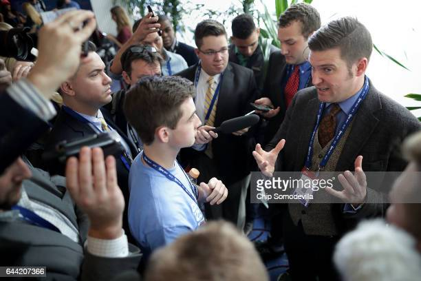 White supremacist Richard Spencer debates race with a young person during the first day of the Conservative Political Action Conference at the...