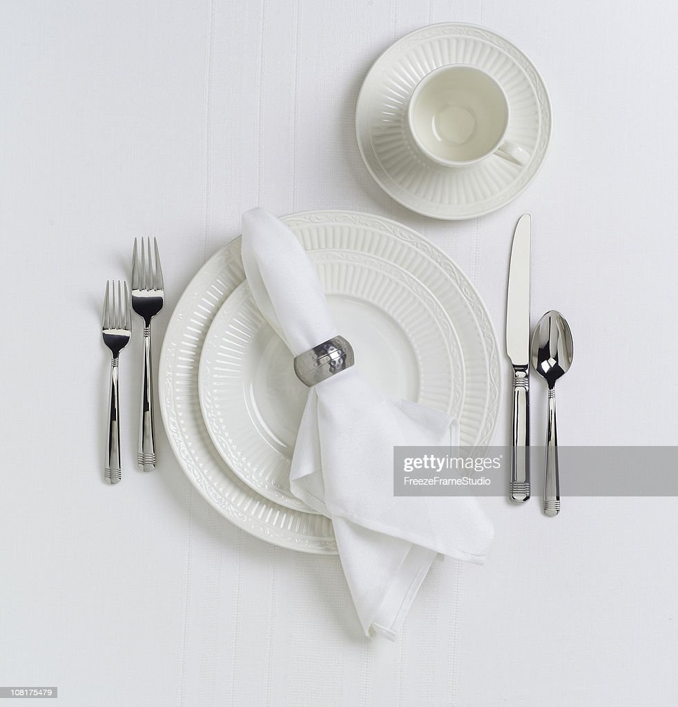 White Table Place Setting with Dishes : Stock Photo