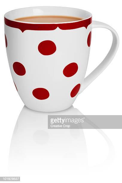 White tea mug with red polka-dot
