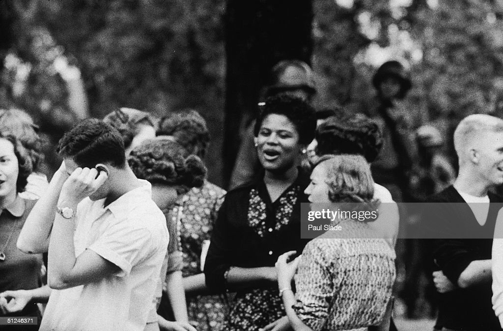 1957, A white teenage boy puts his fingers in his ears as students demonstrate for Civil Rights during the high school desegregation crisis at Little Rock, Arkansas.