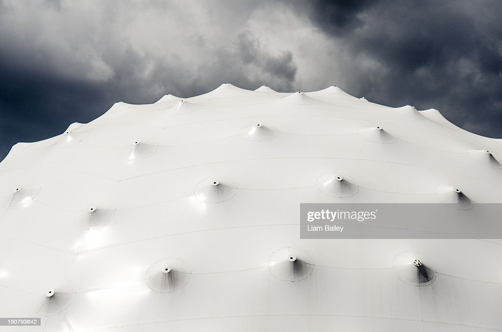White tent roof with stormy sky background : Stock Photo