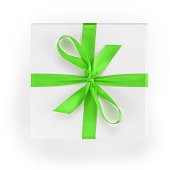 white textured gift box with green ribbon percent symbol, from above