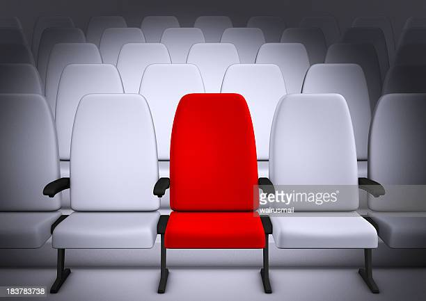 White Theatre style seating with middle chair in red