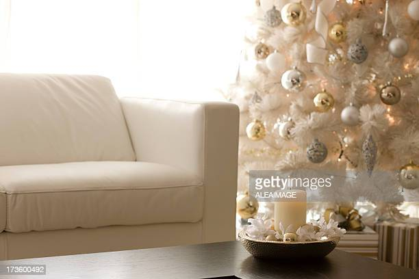 White themed room with candles and Christmas decorations