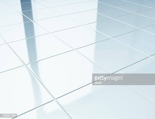 White tiles on a floor in bathroom