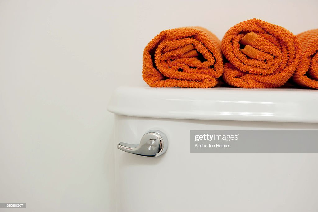 White toilet with towels