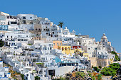 Beautiful view of white town on the island of Santorini, Greece, on a sunny day.