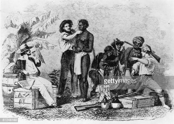 White traders inspect African slaves during a sale circa 1850 Wood engraving by Whitney Jocelyn Annin from 'Captain Canot or Twenty years of an...