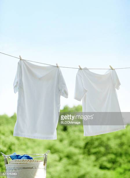 White T-shirts hanging on clothes line