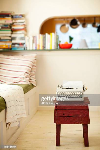 White typewriter on a small wooden table