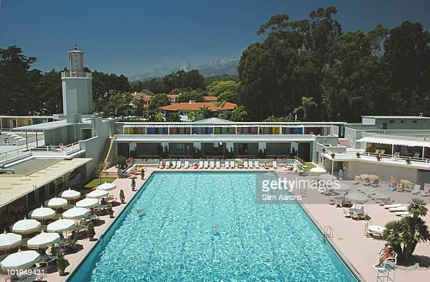 White umbrellas line a swimming pool in Monte Carlo July 1975