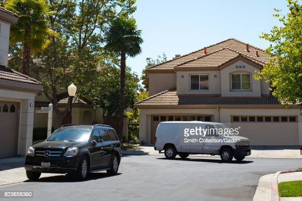 A white van for a third party Amazoncom delivery contractor drives down a suburban street in the San Francisco Bay Area town of San Ramon California...