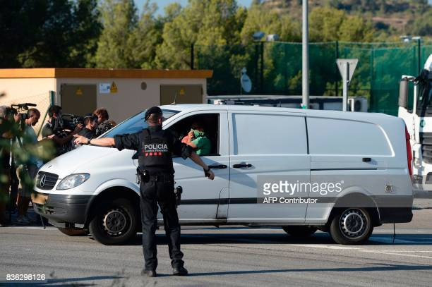 A white van of the Spanish antiterrorism police leaves the site where Moroccan suspect Younes Abouyaaqoub was shot on August 21 2017 near Sant...