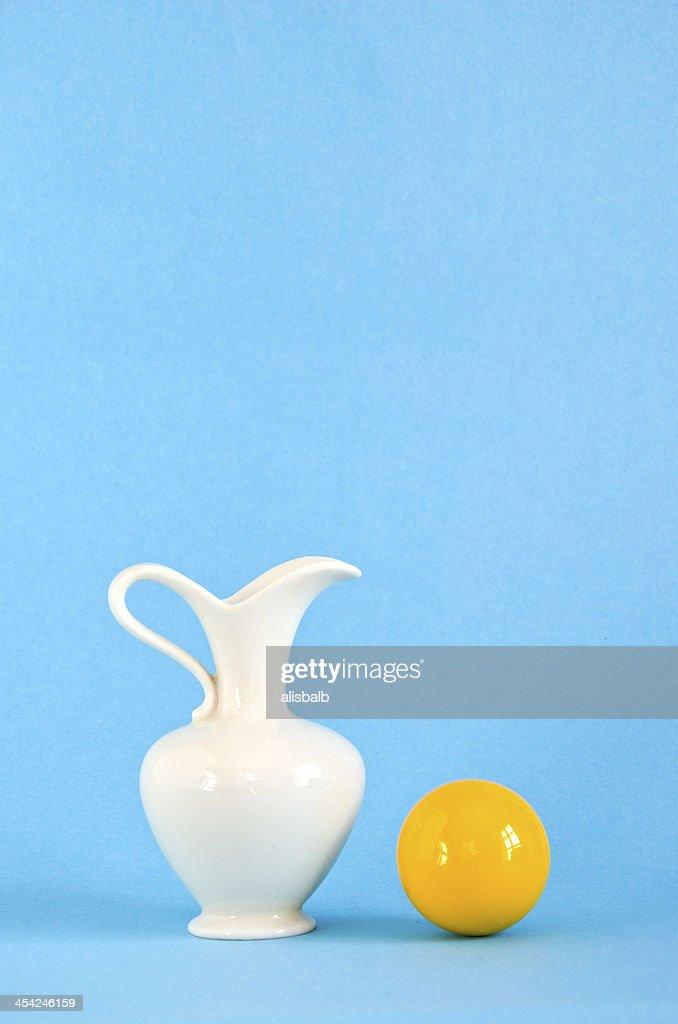 white vase and yellow ball : Stock Photo