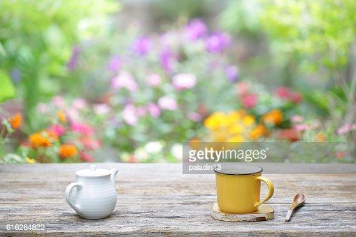 white vintage  teapot  with yellow mug : Stock Photo