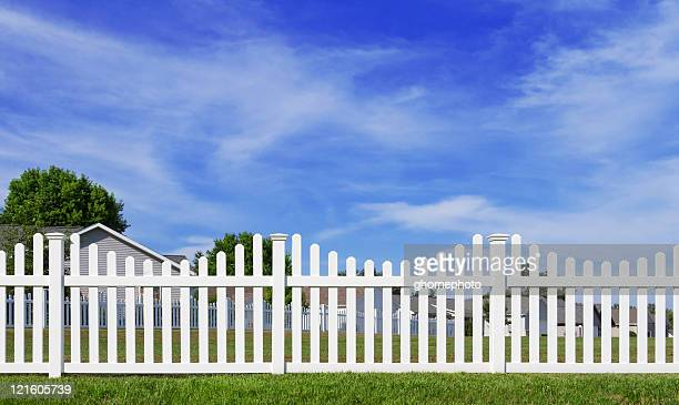 White vinyl fence and blue sky